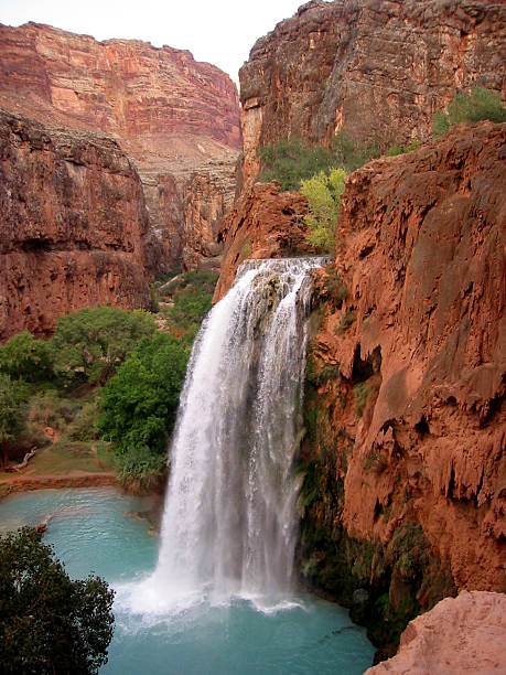 Blue waterfall - red canyon stock photo