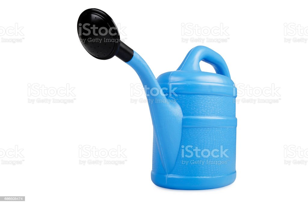 Blue watering can zbiór zdjęć royalty-free