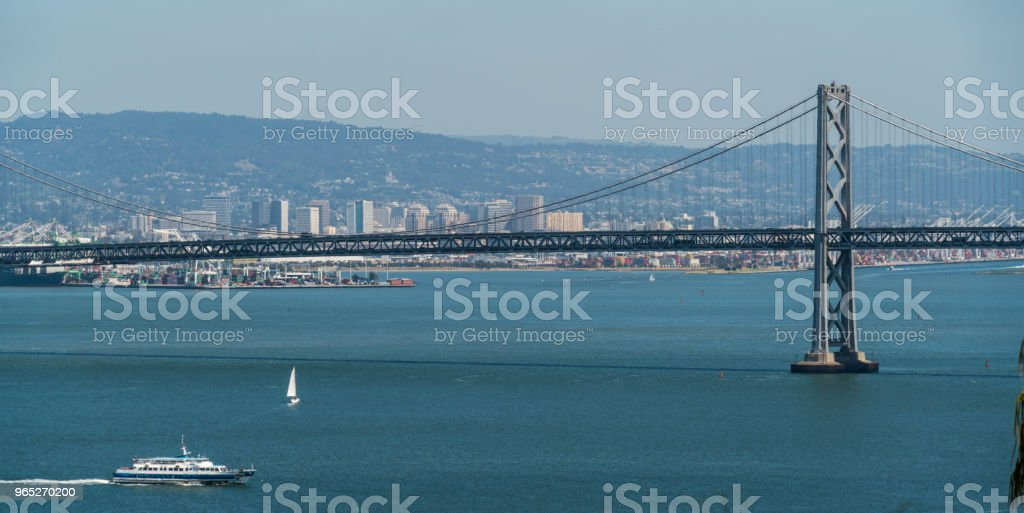 Blue waters of San Francisco Bay with Oakland in the background - Oakland Bay Bridge to San Francisco , California Suspension bridge over the Bay Area royalty-free stock photo