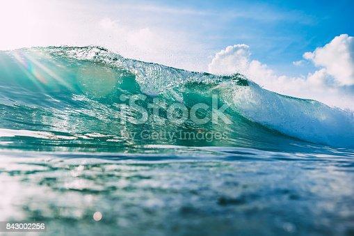 istock Blue wave in ocean and sky in tropics 843002256