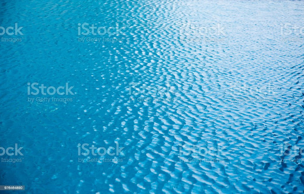 blue wave on water at swimming pool for background stock photo