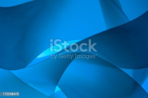 Abstract background of waves with colors of navy blue, royal blue and turquoise.  There are at least four waves in view.
