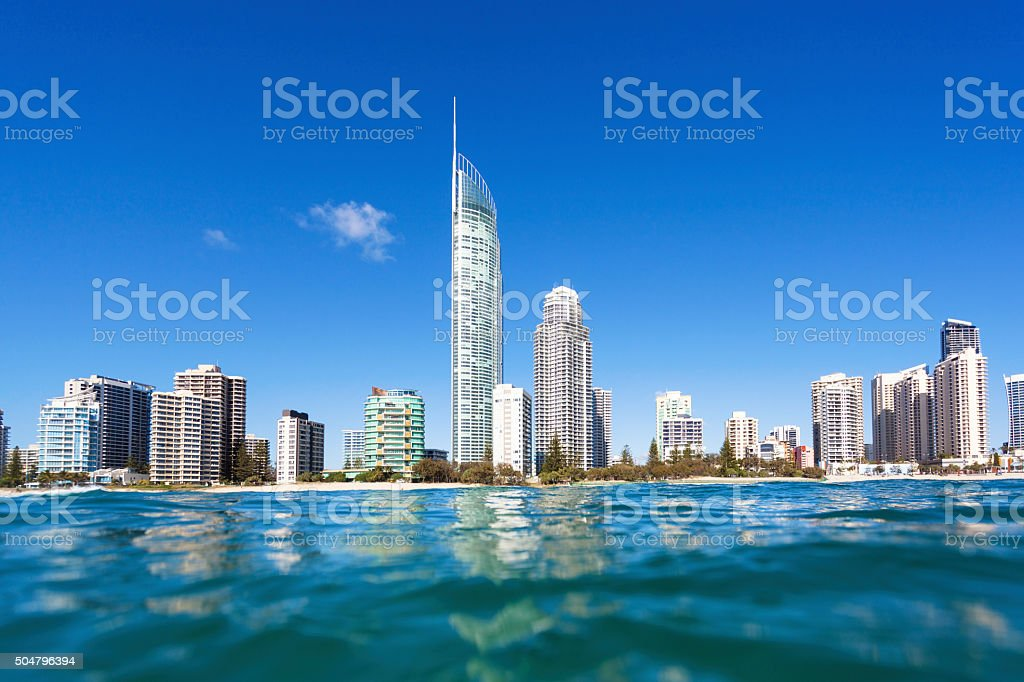Blue waves rolling on Surfers Paradise beach stock photo