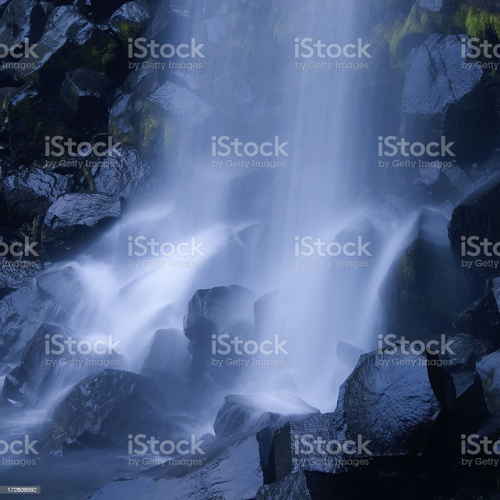 Blue Wet Stones and Waterfall stock photo