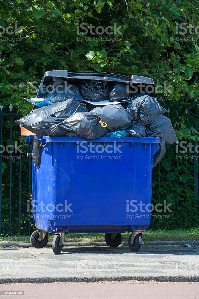 Blue wheeled garbage can stock photo