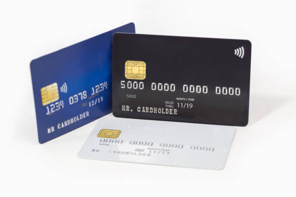 Blue, white and black credit cards on white background stock photo