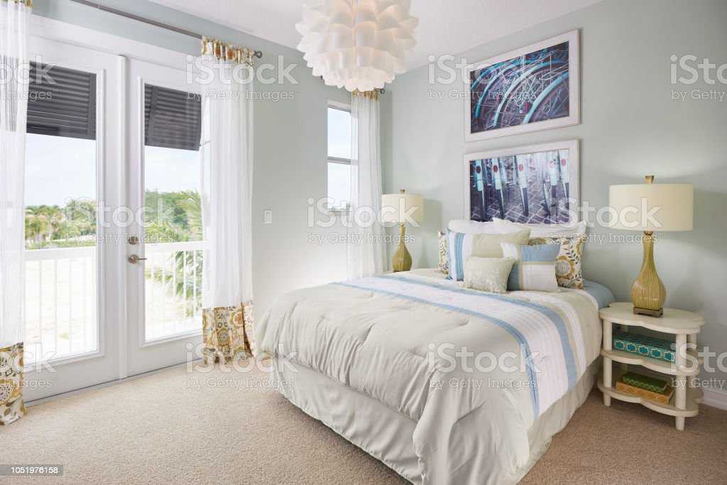 A Blue, White, and Off-White, Bedroom with a Bicycle Theme in a Model Home stock photo