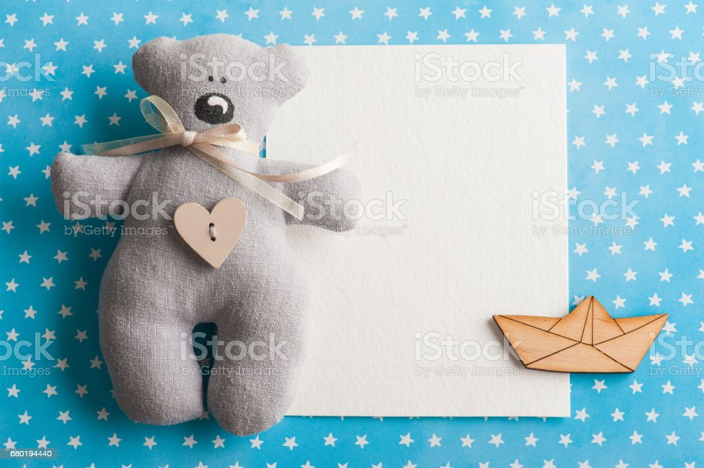Blue white stars background with teddy bear stock photo
