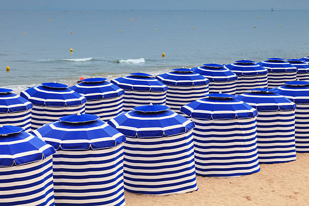 Blue White Stripe Beach Huts Cabourg Normandy France stock photo
