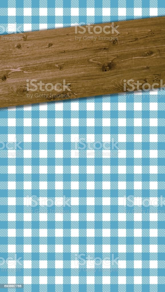 Blue white tablecloth and wooden plank stock photo