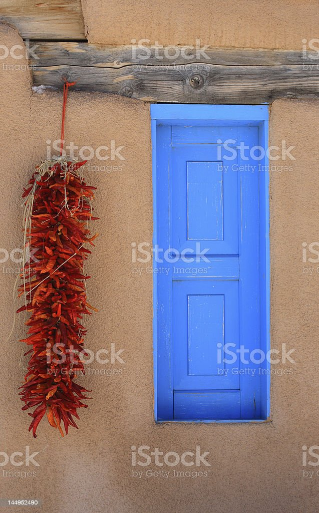 Blue window and Ristras stock photo