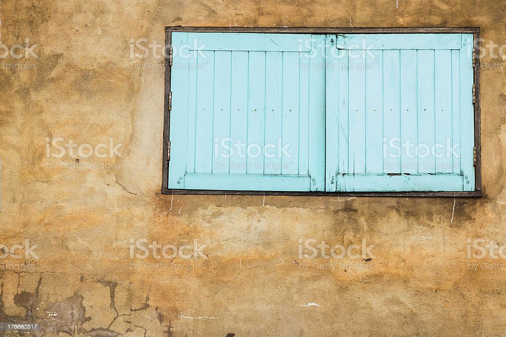 blue window on the old wall with space royalty-free stock photo