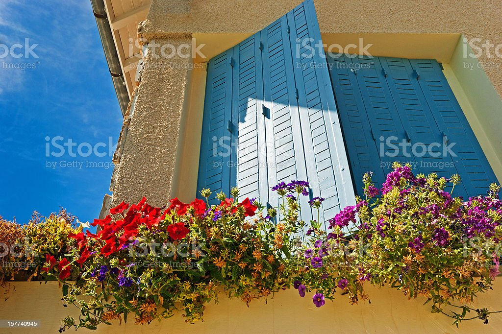 Blue window shutters on a French Gite stock photo