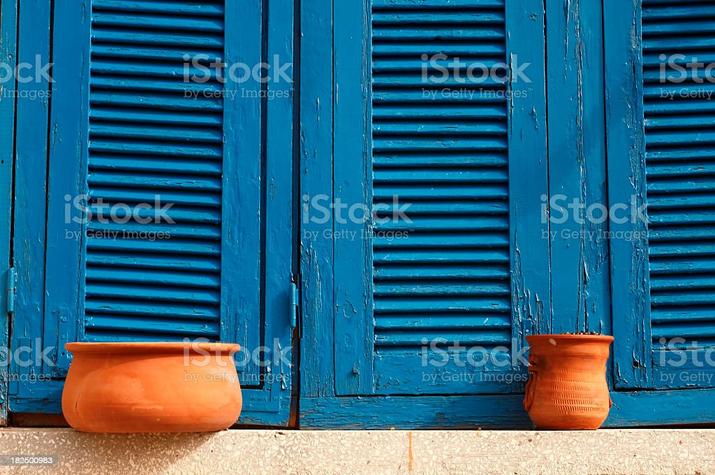 Blue window with pots stock photo