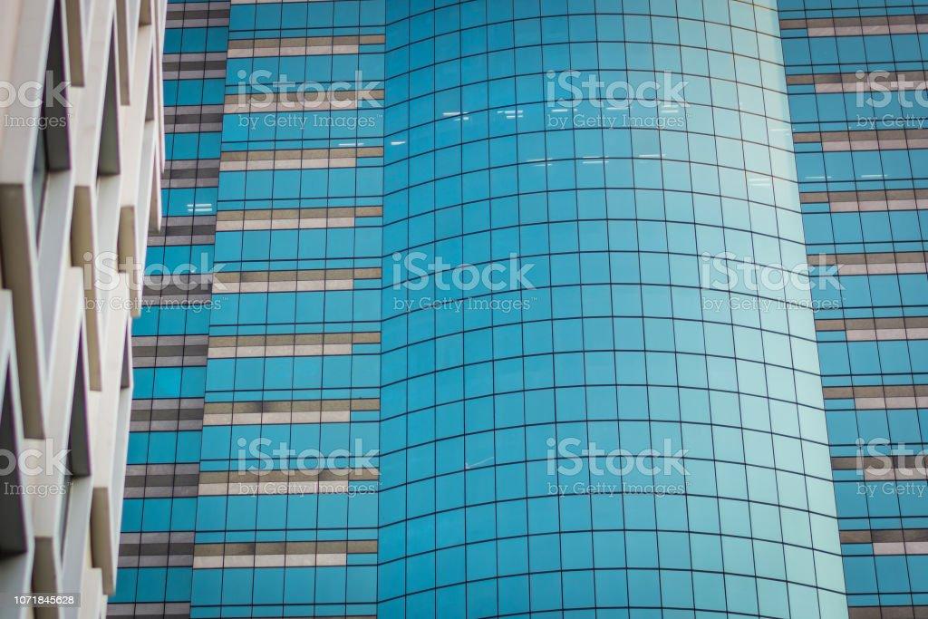 Blue windows in office building in Bangkok, Thailand – zdjęcie