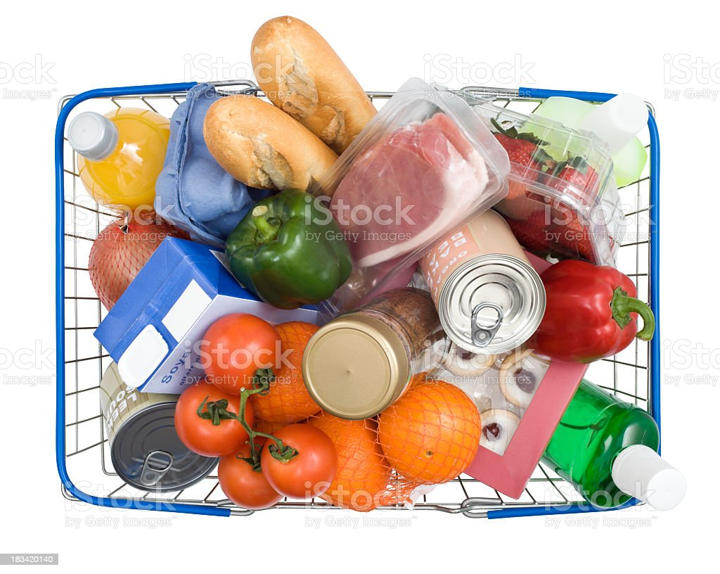 Blue wire shopping basket filled with a variety of groceries stock photo