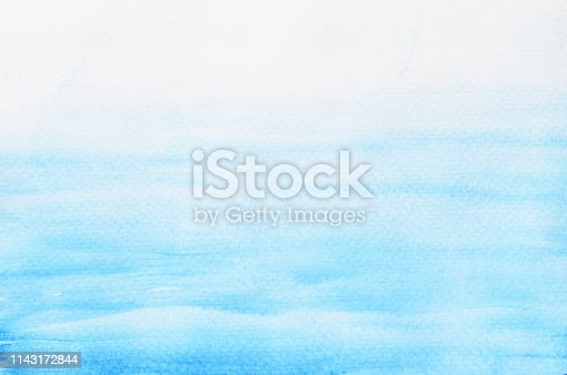 istock Blue with green stains flow on white surface 1143172844