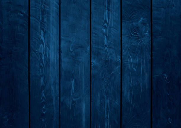 Blue wood grunge background Close up on wood planks panel. Color treatment and vignetting made with Photoshop. dark blue stock pictures, royalty-free photos & images