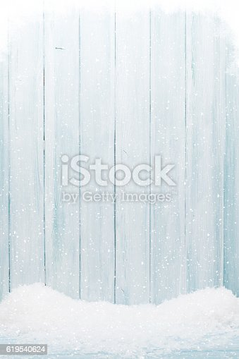 istock Blue wood texture with snow 619540624