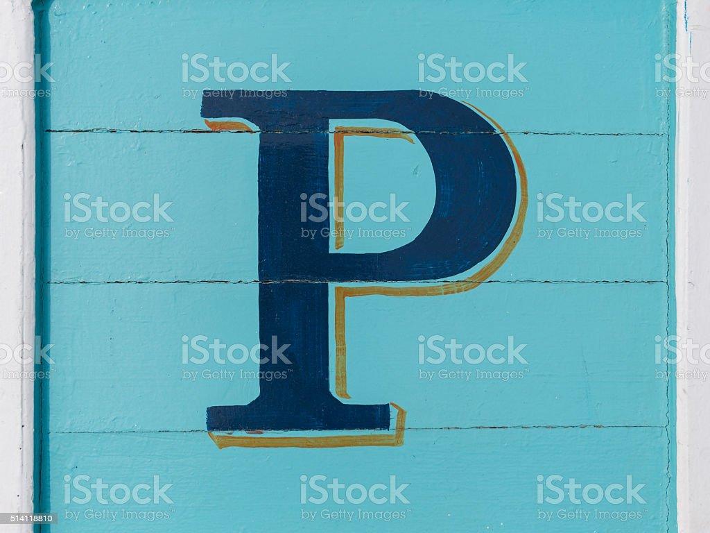 Blue wooden alphabet block, letter P stock photo