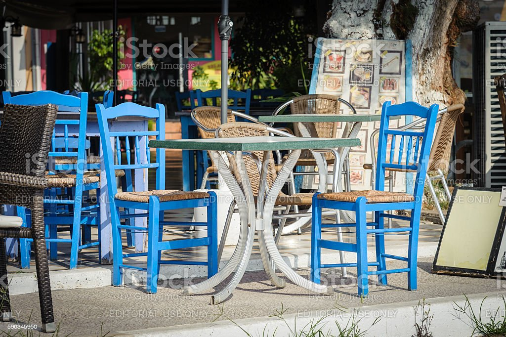 Blue wooden chairs and table at traditional Greek tavern royalty-free stock photo