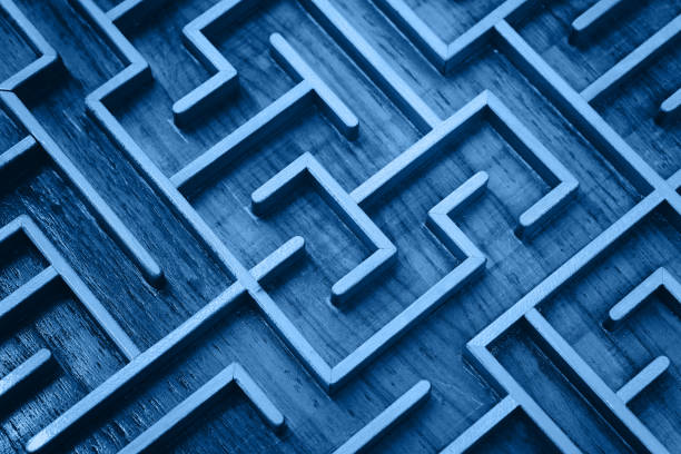 Blue wooden labyrinth maze puzzle close up Close up of blue toned wooden labyrinth maze, classic toy puzzle game, elevated high angle view challenge stock pictures, royalty-free photos & images