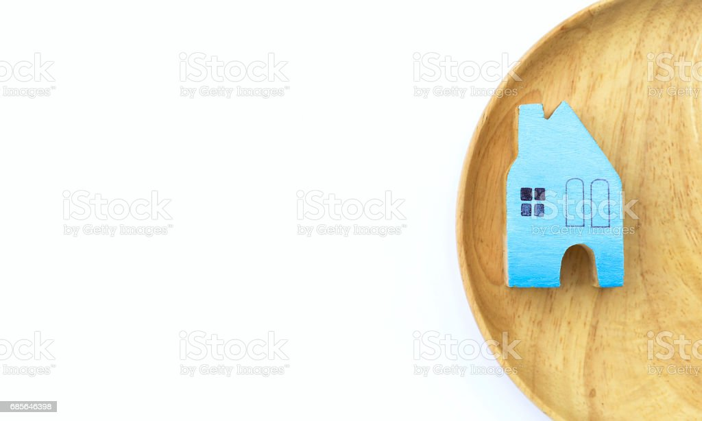 Blue wooden miniature house on wooden tray on white background 免版稅 stock photo