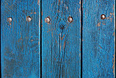 istock blue wooden planks, palisade background 611871704