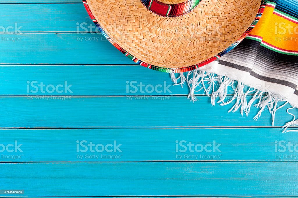 Blue wooden planks with Mexican hat and blanket stock photo
