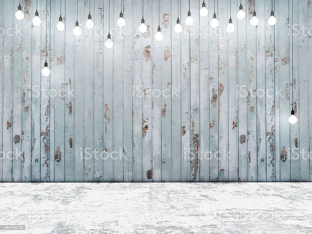 Blue wooden wall with light bulbs, background stock photo