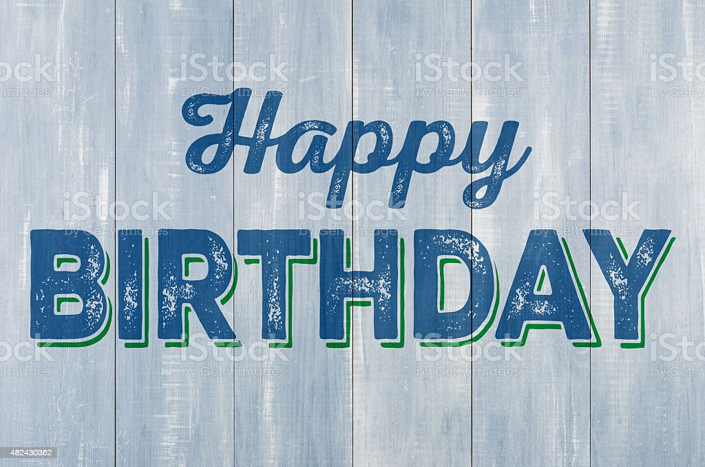 Blue wooden wall with the inscription Happy Birthday stock photo