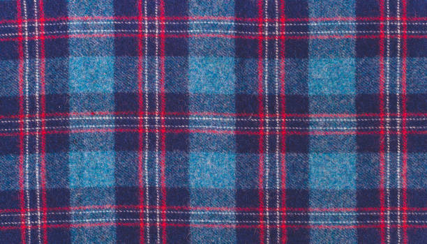 Blue wool checkered fabric Texture of checkered woolen fabric. Scenic woolen plaid with a Scottish pattern plaid stock pictures, royalty-free photos & images