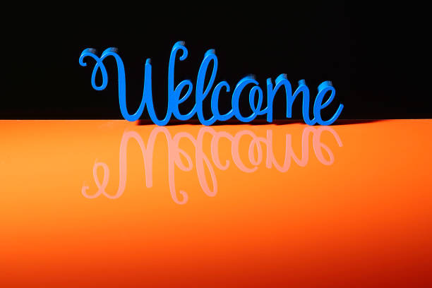 Blue word Welcome and space for copy - foto stock
