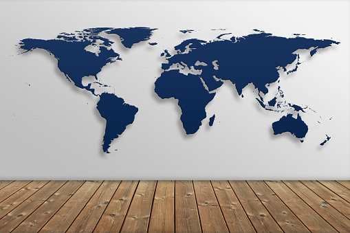 istock Blue World map over wall 930989418