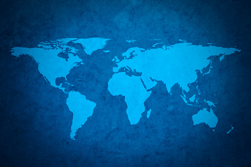 Blue world map on textured grungy background. Map traced from NASA archive public resource.
