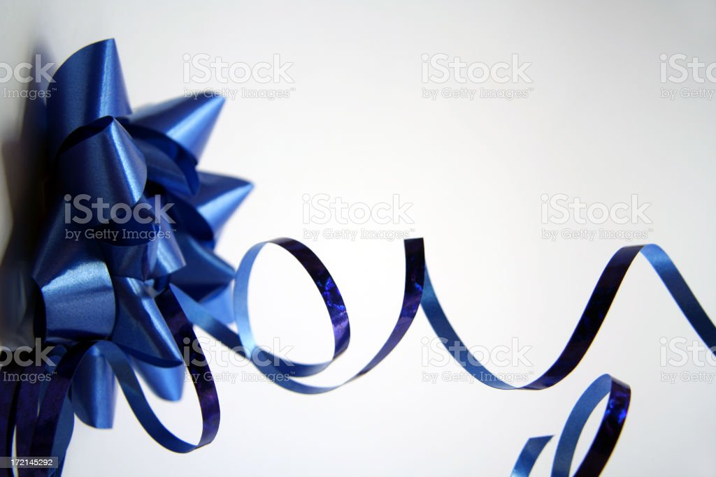 Blue Wrapping Bow and Curling Ribbon On Isolated Background stock photo
