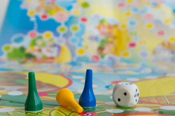 Blue, yellow and green plastic chips, dice and Board games for children .  selective focus stock photo