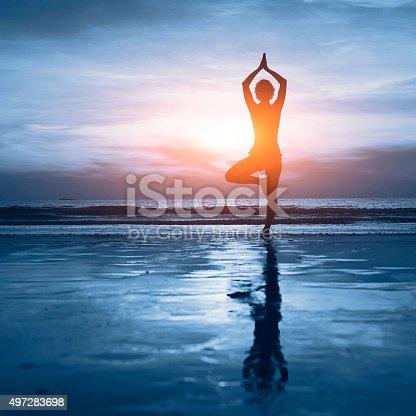 istock blue yoga background 497283698