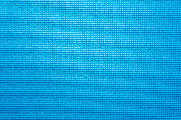 Blue yoga mat texture background stock photo