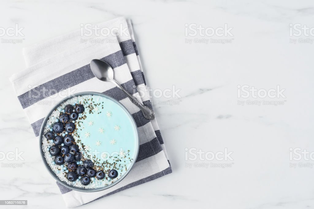 Blue yogurt smoothie bowl stock photo