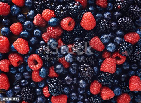istock blueberies, raspberries and black berries shot top down 485349336