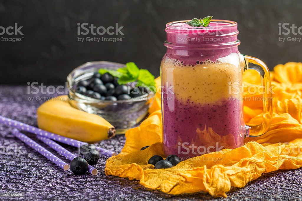 Blueberrie smoothie in a glass stock photo