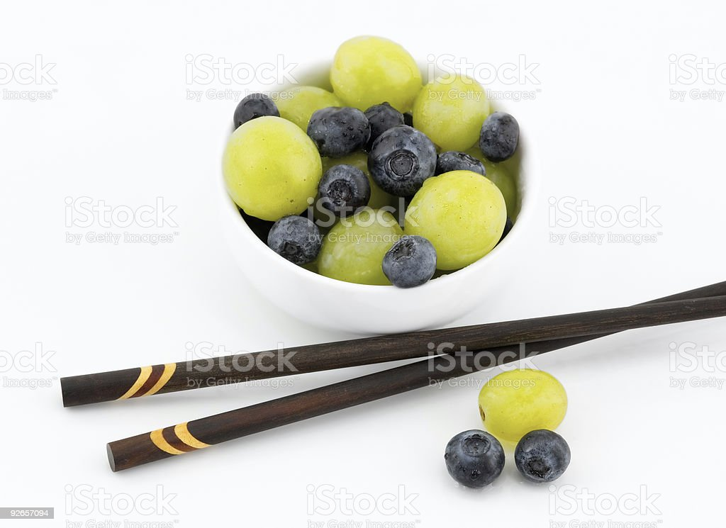 Blueberries and Grapes in White Bowl with Chopsticks royalty-free stock photo