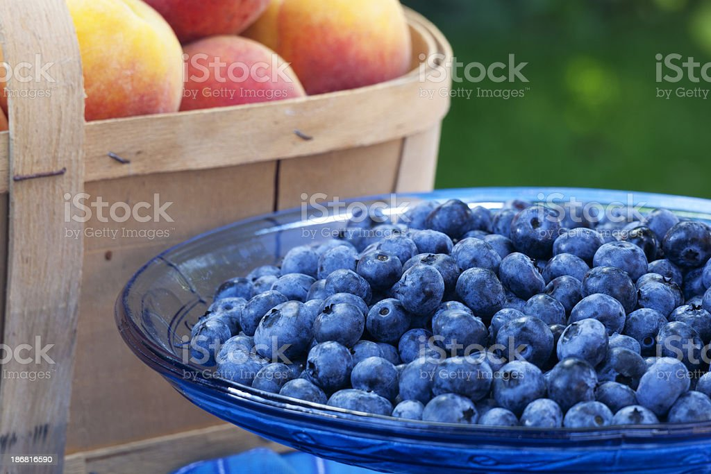 Blueberries and Peach Basket stock photo