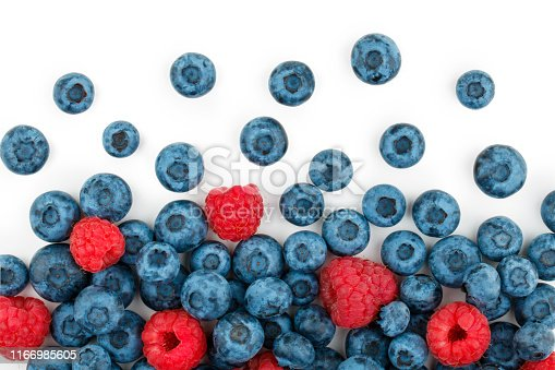 670420880istockphoto Blueberries and raspberries isolated on white background 1166985605