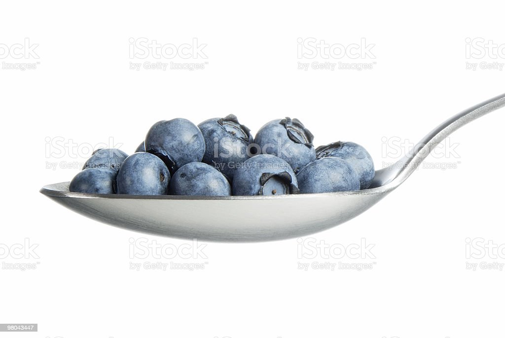 Blueberries and spoon royalty-free stock photo