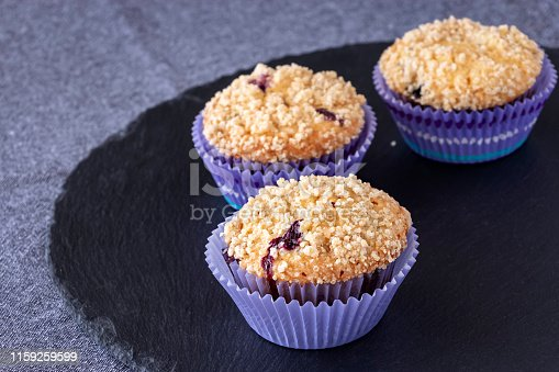 istock Blueberries Apple Oats streusel Muffins on slate board. Selective focus. Copy space for text. Healthy breakfast concept. 1159259599