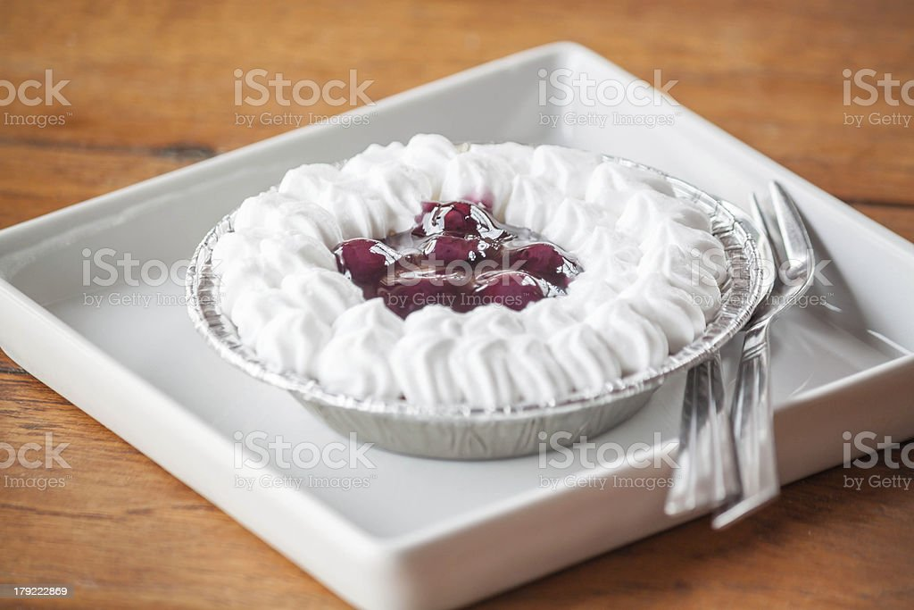 Blueberries cheese cupcake on white plate with spoon and fork royalty-free stock photo