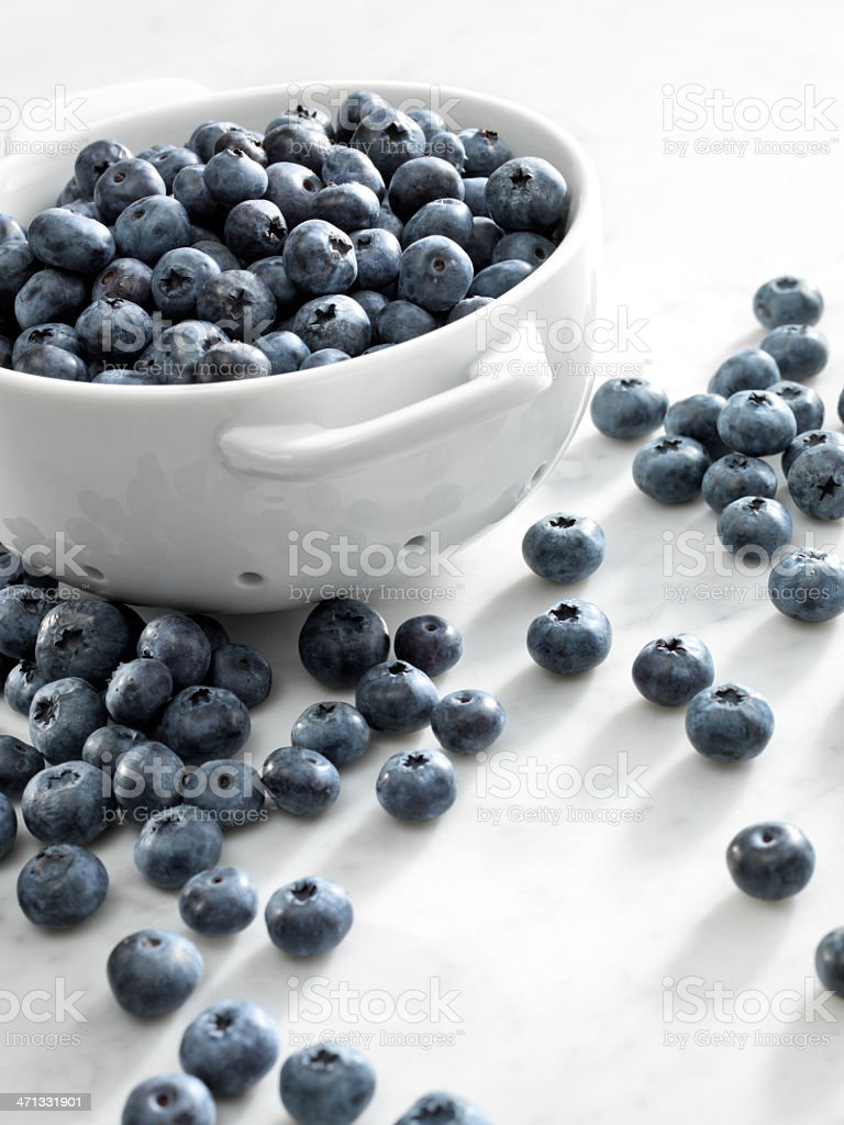 Blueberries in a white bowl stock photo