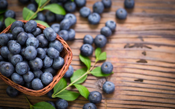 blueberries in the basket - blueberry stock pictures, royalty-free photos & images